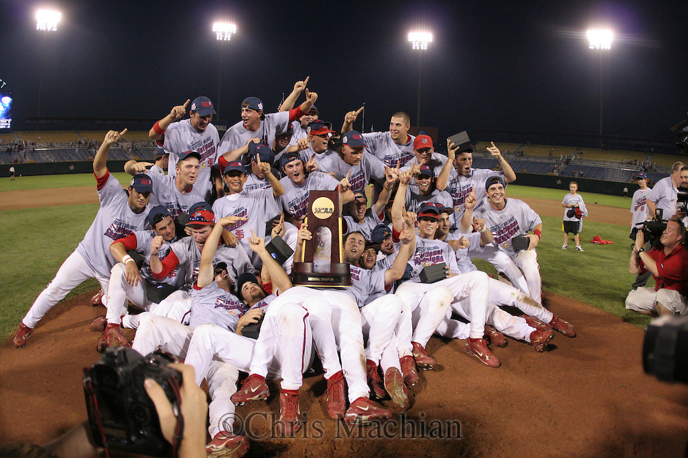 6/25/08 Omaha, NEB  Fresno State holds the trophy after their victory  at Rosenblatt Stadium during the College World Series..Michelle BishopMinorwhite Studios ..Contact person.Chris Machian 402 578 6456