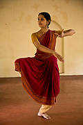 "Ganga Thampi, teaches young   dancers  movement, rhythm and expression, known as ""nritya"" and seen here a lesson in ""abhinaya"", or stylized expressions at the traditional and highly prestigious Kalakshetra school for the arts, Chennai. The school was founded in 1936 and due to its exacting and demanding schedule is considered India's formost classical dance academy of this ancient cultural art heritage that is informally known as ""temple dancing"" and that dates back to the Natya Shastra, the 2000 year old text that lays down the principles of Indian dramatic theory and performance. Tamil Nadu, India"