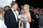 MARQUIS OF MILFORD HAVEN; MARCHIONESS OF MILFORD HAVEN, The Goodwood Ball. In aid of Gt. Ormond St. hospital. Goodwood House. 27 July 2011. <br /> <br />  , -DO NOT ARCHIVE-© Copyright Photograph by Dafydd Jones. 248 Clapham Rd. London SW9 0PZ. Tel 0207 820 0771. www.dafjones.com.