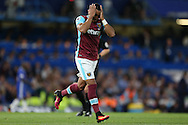Dimitri Payet of West Ham United reacts as he holds his head in his hands after missing a chance to score. Premier league match, Chelsea v West Ham United at Stamford Bridge in London on Monday 15th August 2016.<br /> pic by John Patrick Fletcher, Andrew Orchard sports photography.
