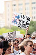 Protestors held signs against the Trump administration's policy of immigrant family separation during the Families Belong Together rally, part of a nation wide campaign against the immigration policy.