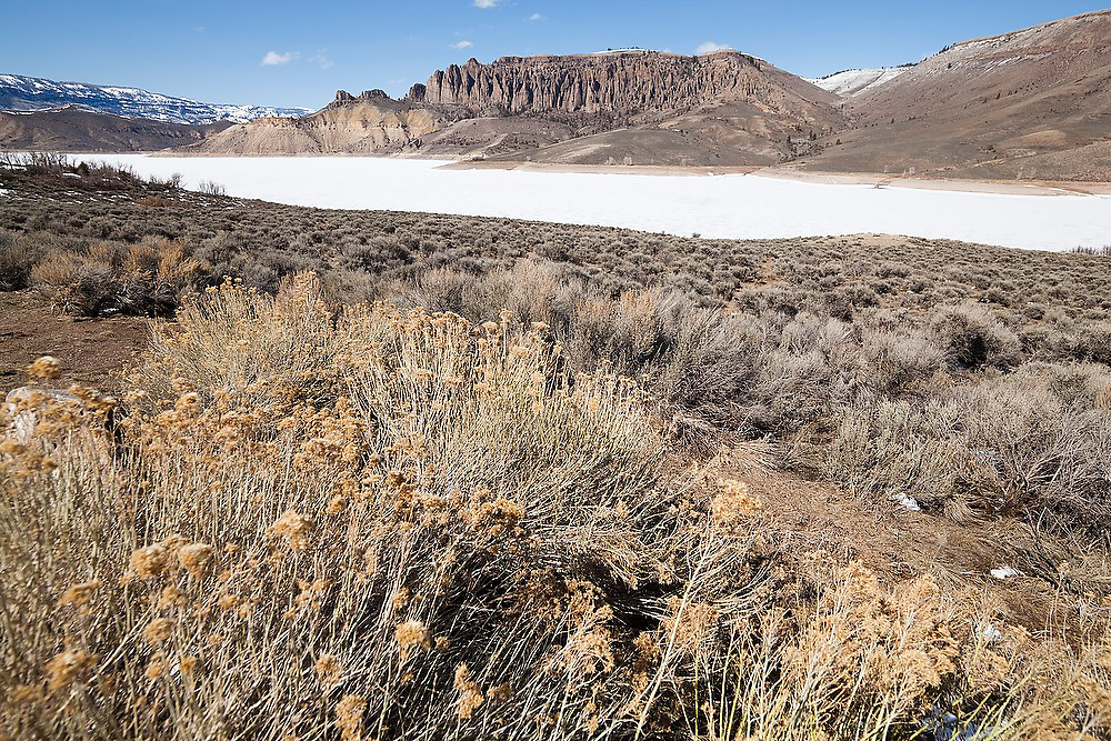 View of the Dillon Pinnacles above the frozen surface of the Blue Mesa Reservoir in Curecanti National Recreation Area, Colorado.