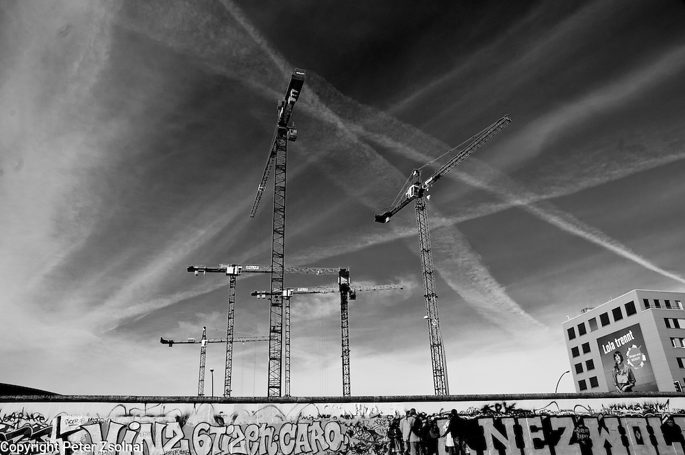 Cranes next to the wall of Berlin, Germany