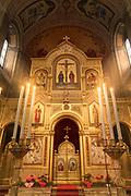 Interior of illuminated altar of Saint Spyridon Serbian Orthodox Church in Trieste, Italy