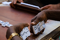 HAVANA, CUBA - CIRCA JANUARY 2020: Hands of people playing Dominoes in the streets of Havana.