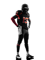 one american football player standing in silhouette shadow on white background