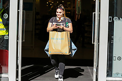© Licensed to London News Pictures. 15/06/2020. London, UK. A shopper with a shopping bag leaves Primark in Wood Green, north London as non-essential stores reopen after three months of COVID-19 lockdown. Photo credit: Dinendra Haria/LNP
