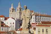 São Vicente statue and São Vicente Monastery seen from Portas do Sol lookout in Lisbon.