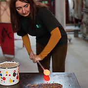 VENICE, ITALY - DECEMBER 18:  Elena Rosso a glass  artist in Murano shapes incandescent glass on a worktable on December 18, 2010 in Venice, Italy. There are only few female glass artists is Italy and they face continuous challanges in a traditionally male dominated field.