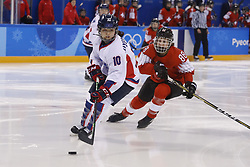 February 18, 2018 - Pyeongchang, KOREA - Korea forward Jiyeon Choi (10) and Switzerland forward Phoebe Staenz (88) in a hockey game between Switzerland and Korea during the Pyeongchang 2018 Olympic Winter Games at Kwandong Hockey Centre. Switzerland beat Korea 2-0. (Credit Image: © David McIntyre via ZUMA Wire)