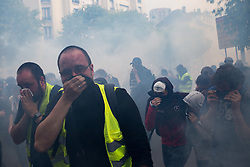 May 1, 2019 - Paris, France - The cortege of demonstrators under tear gas fire during the inter-union demonstration on May 1 in Paris, which also included yellow vests, in Paris, France, on May 1, 2019. Clashes between the black-blocks and the police took place along the entire route between Montparnasse and Place d'Italie. (Credit Image: © Emeric Fohlen/NurPhoto via ZUMA Press)