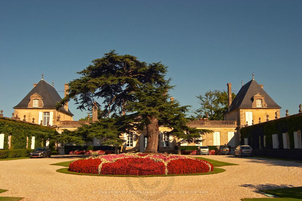 The court yard to Chateau Beychevelle in Saint Julien. Beautiful flower arrangements and huge cedar tree