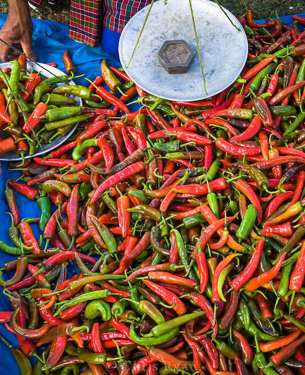 Chili peppers for sale at a local market. The hot peppers, combined with cheese, are a popular Bhutanese dish.