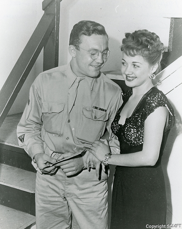 1944 Actress Olga San Juan chats with a serviceman at the Hollywood Canteen
