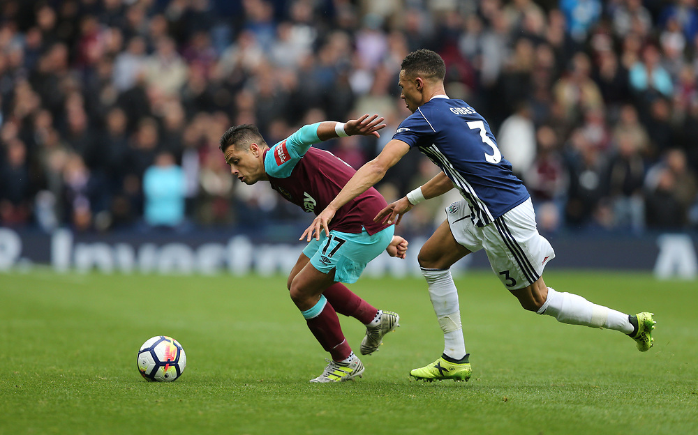 West Ham United's Javier Hernandez and West Bromwich Albion's Kieran Gibbs<br /> <br /> Photographer Rob Newell/CameraSport<br /> <br /> The Premier League - West Bromwich Albion v West Ham United - Saturday 16th September 2017 - The Hawthorns - West Bromwich<br /> <br /> World Copyright © 2017 CameraSport. All rights reserved. 43 Linden Ave. Countesthorpe. Leicester. England. LE8 5PG - Tel: +44 (0) 116 277 4147 - admin@camerasport.com - www.camerasport.com