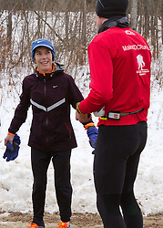 Gary Allen runs from Maine to Washington DC; Joan Sameulson laughs with Gary Allen after early morning run together on Raymond Road in Brunswick
