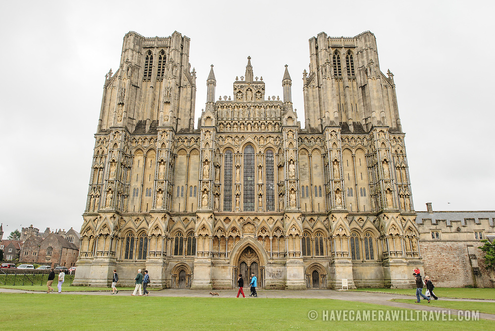 The ornate front face of Wells Cathedral in Wells, Somerset, United Kingdom. Some of the building dates back to the 10th Century.