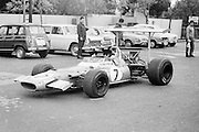 British Matra driver, Jackie Stewart, drives his car in the pits before the training sessions during the 1969 Spanish Grand Prix at the Montjuïc urban circuit in Barcelona, Spain.