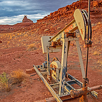 An oild rig pumps near Mexican Hat Rock, previously on the boundary of Bears Ears National Monument before it was downsized by the Trump administration to allow oild and gas exploration.