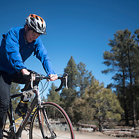021415      Cayla Nimmo<br /> <br /> Logan Ott from Mancos Colorado is the first participant to start the bike ride down the mountain for the annual Quadrathalon in Grants Saturday. Ott took first place overall in the race, with a time of 4:09:11.