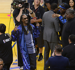 Snoop Dog finds his seat before the Golden State Warriors play host to the Cleveland Cavaliers for Game 5 of the NBA Finals at Oracle Arena in Oakland, Calif., on Monday, June 12, 2017. (Photo by Dan Honda/Bay Area News Group/TNS) *** Please Use Credit from Credit Field ***