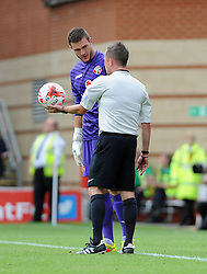 Referee David Webb checks on Walsall's Richard O'Donnell - photo mandatory by-line David Purday JMP- Tel: Mobile 07966 386802 23/08/14 - Leyton Orient v Walsall - SPORT - FOOTBALL - Sky Bet Leauge 1 - London -  Matchroom Stadium