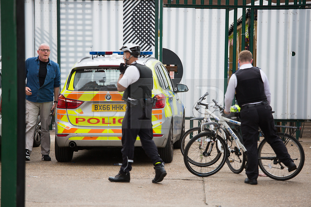 © Licensed to London News Pictures.  01/08/2021. London, UK. Police guard the scene outside The Cause nightclub in Tottenham, north London. A man in his 20s died in hospital and two others are ill after visiting the nightclub early on Saturday. Photo credit: Marcin Nowak/LNP
