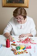 Vinka Mareković making jewellery for traditional Croatian folk costumes at her home in Sesvetski Kraljevec, a village near Zagreb, Croatia © Rudolf Abraham