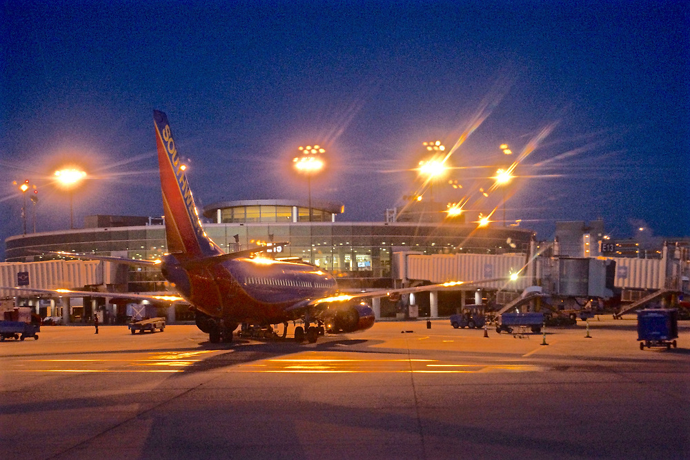 Night lights, dawn, Philadelphia airport and airplane