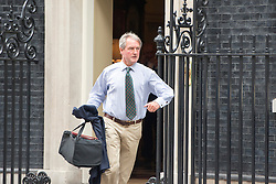 © Licensed to London News Pictures. 08/07/2014. Westminster, UK Owen Patterson, Conservative MP, Secretary  of  State  for  Energy  and  Climate Change,  leaving Downing Street today 8th July 2014 after the weekly cabinet meeting. Photo credit : Stephen Simpson/LNP