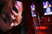 TV screens are showing people's faces at the time of their climax in the Orgasm Tunnel at Amora, the Academy of Sex and Relationships,on Tuesday, April 17, 2007, in London, UK. The world's first visitor attraction dedicated to love, sex and relationships opens its door officially tomorrow (18th of April 2007) in Piccadilly. The permanent interactive attraction, Amora, expects to draw over half a million, 18+ visitors in the first year and fuses entertainment, excitement and education in a unique powerful sensory experience. With seven zones covering every aspect of relationships from first filtrations and dating to fantasy and fetish. Visitors can explore the science of attraction - what they find attractive and why, learn how to enhance their skills and even create what their perfect partner might look like. Male and female models help demystify erogenous zones, G-spot and prostate, while insights and technique tips are offered on various topics. Sexual awareness and well-being are also covered thoroughly.