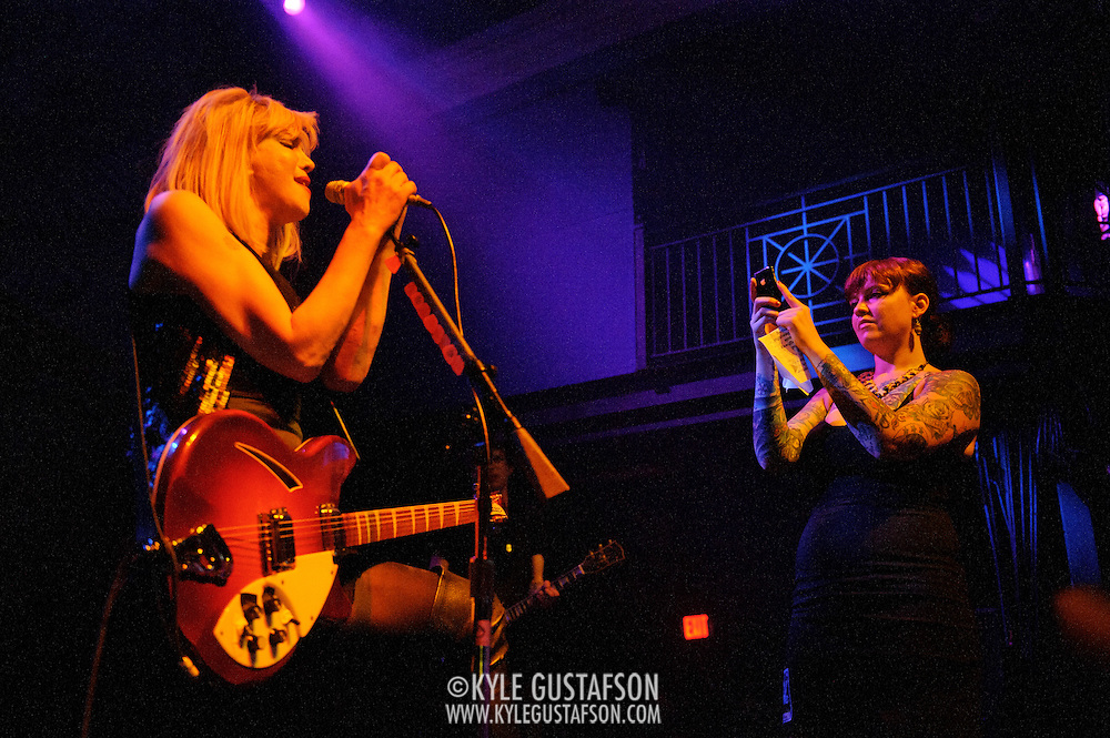 Washington, D.C. - June 27th, 2010:  Courtney Love and Hole play a sold out show at the 9:30 Club in Washington, D.C. Love behaved erratically all night, including having her assistant film the entire show from the stage on her iPhone. (Photo by Kyle Gustafson/For The Washington Post)