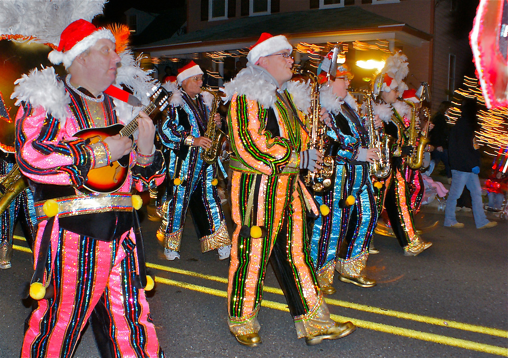 Adult mummer band in costume in Cape May holiday parade Family activities