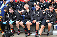 Liverpool manager Brendan Rogers (r) and his management team take to their seats before the pre-season friendly match, Preston North End v Liverpool at Deepdale in Preston, England on Saturday 19th July 2014.<br /> pic by Chris Stading, Andrew Orchard sports photography.