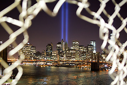 The Tribute in Light rises behind the lower Manhattan adjacent to the World Trade Center, Thursday, Sept. 11, 2014 in New York. The tribute, an art installation of 88 searchlights aiming skyward in two columns, is a remembrance of the Sept. 11, 2001, attacks. Photo by Matt Borowick/ABACAPRESS.COM  | 465976_007 New York Etats-Unis United States