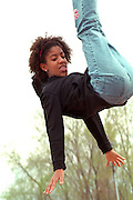 Gymnast age 17 bouncing at Cinco de Mayo festival.  St Paul Minnesota USA