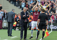 Football - 2017 / 2018 Premier League - West Ham United vs. Everton<br /> <br /> James Collins (West Ham United) applauds the fans before he comes on to make possibly his last appearance at the London Stadium<br /> <br /> COLORSPORT/DANIEL BEARHAM