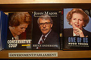 British Prime Minister, John Major and his political predecessor, Margaret Thatcher, adorn the covers of their respective biographies on sale in the Conservative partys Central Office bookshop on 11th March 1992. Thatcher served as PM from 1979 to 1990 and Major, from 1990 to 1997.