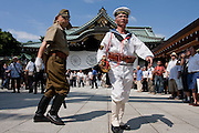Nationalist in Imperial army and navy uniforms at Yasukuni Shrine. On August 15th every year people gather at Yasukuni Shrine to commemorate the end of the Pacific War. Notionally a call for remembrance and continued peace it is also a Mecca for right wing nationalist including  the paramilitary Uyoku Dantai. Tokyo, Japan, August 15th 2009