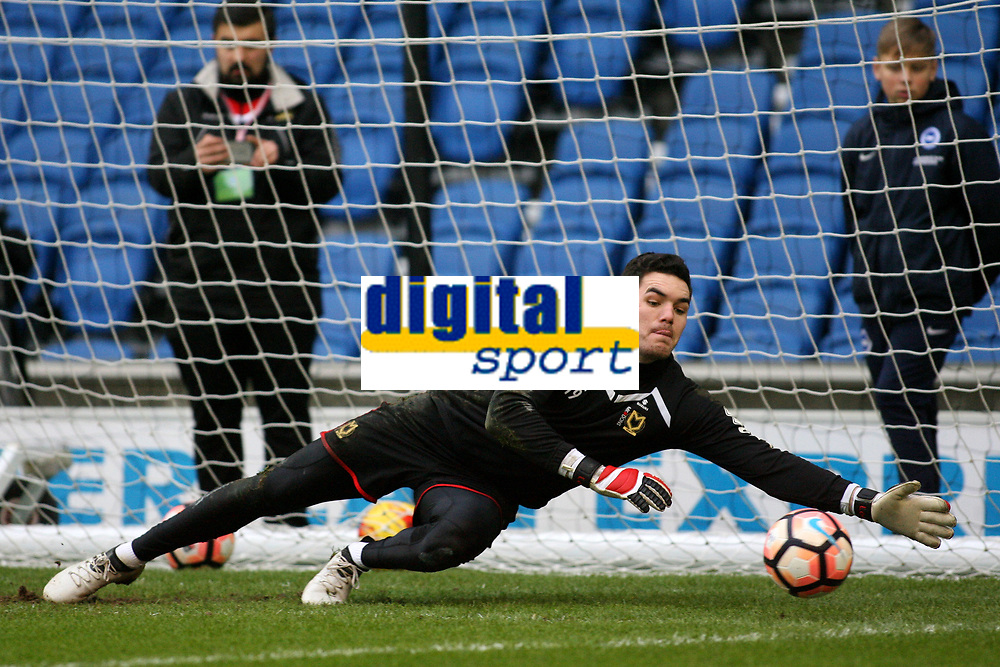 Football - 2016 / 2017 FA Cup - Third Round: Brighton and Hove Albion vs. MK Dons<br /> <br /> Lee Nicholls of MK Dons during the pre match warm up at the Amex Stadium Brighton<br /> <br /> Colorsport/Shaun Boggust