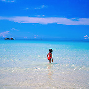 A beach scene by the pristine waters at White Beach on October 7, 2008 in Boracay Island, the Philippines. Photo Tim Clayton..Asian tourists at White Beach, Boracay Island, the Philippines...The 4 km stretch of White beach on Boracay Island, the Philippines has been honoured as the best leisure destination in Asia beating popular destinations such as Bali in Indonesia and Sanya in China in a recent survey conducted by an International Travel Magazine with 2.2 million viewers taking part in the online poll...Last year, close to 600,000 visitors visited Boracay with South Korea providing 128,909 visitors followed by Japan, 35,294, USA, 13,362 and China 12,720...A popular destination for South Korean divers and honeymooners, Boracay is now attracting crowds of tourists from mainland China who are arriving in ever increasing numbers. In Asia, China has already overtaken Japan to become the largest source of outland travelers...Boracay's main attraction is 4 km of pristine powder fine white sand and the crystal clear azure water making it a popular destination for Scuba diving with nearly 20 dive centers along White beach. The stretch of shady palm trees separate the beach from the line of hotels, restaurants, bars and cafes. It's pulsating nightlife with the friendly locals make it increasingly popular with the asian tourists...The Boracay sailing boats provide endless tourist entertainment, particularly during the amazing sunsets when the silhouetted sails provide picture postcard scenes along the shoreline...Boracay Island is situated an hours flight from Manila and it's close proximity to South Korea, China, Taiwan and Japan means it is a growing destination for Asian tourists... By 2010, the island of Boracay expects to have 1,000,000 visitors.