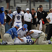 Memphis wide receiver Tannar Rehrer (85) receives medical attention after a severe hit by Central Florida linebacker Terrance Plummer (41) during an NCAA football game between the Memphis Tigers and the Central Florida Knights at Bright House Networks Stadium on Saturday, October 29, 2011 in Orlando, Florida.(AP Photo/Alex Menendez)