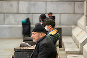 Homeless and poor people are seen waiting for food to be feed by the Sikh Welfare Action Team (SWAT) near Trafalgar Square in London, Britain, on Sunday, May 3, 2020. Homeless people in the United Kingdom facing the risk of death from Coronavirus as they're the most vulnerable in regards to protection against Covid-19. Many homeless men and women are seen in central London, the British capital throughout the week, while the government is increasing pressures on its residents to self-isolate. <br /> Last year alone, 320,000 people were recorded as homeless in Britain, analysis from housing charity Shelter suggests. It is a rise of 13,000, or 4%, on last year's figures and equivalent to 36 new people becoming homeless every day.<br /> Britons are now in their sixth week of lockdown due to the Coronavirus pandemic. Countries around the world are taking increased measures to stem the widespread of the SARS-CoV-2 coronavirus which causes the Covid-19 disease. (Photo/ Vudi Xhymshiti)
