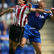 Leicester City's Matt Elliott is challenged in the air by Athletic Bilboa's Aduriz who was later sent off for elbowing him