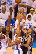 June 2, 2012; Oklahoma City, OK, USA; Oklahoma City Thunder forward Serge Ibaka (9) guard Thabo Sefolosha (2) and San Antonio Spurs guard Tony Parker (9) attempt to gain control of a rebound during a playoff game  at Chesapeake Energy Arena.  Thunder defeated the Spurs 109-103 Mandatory Credit: Beth Hall-US PRESSWIRE