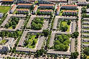 Nederland, Noord-Holland, Amsterdam, 14-06-2012; Slotervaart, met de L-vormige blokken in het onderste deel van de foto van Blueband-dorp. Aan de Jacques Veltmanstraat de flats met rode rode daken en nieuwbouw. De buurt is onderdeel van de Westelijke Tuinsteden, gerealiseerd op basis van het Algemeen Uitbreidingsplan voor Amsterdam (AUP, 1935). Voorbeeld van het Nieuwe Bouwen, open bebouwing in stroken, langwerpige bouwblokken afgewisseld met groenstroken. .This residential area (Slotervaart) is an example of garden cities of Amsterdam-west. Constructed on the basis of the General Extension Plan for Amsterdam (AUP, 1935). Example of the New Building (het Nieuwe Bouwen), detached in strips, oblong housing blocks alternated with green areas, built in fifties and sixties of the 20th century. luchtfoto (toeslag), aerial photo (additional fee required).foto/photo Siebe Swart