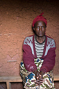 May0016089 . Daily Telegraph..Features..55 year old Valerie who lost her 8 children and husband during the 1994 genocide sits in her bare mud brick home on a Rwandan hillside near Cyangugu. Valerie has over the years received help from the Chaplin family and Rwanda Aid a British charity and recipient of funds from the Daily Telegraph's 2005 Christmas appeal...Rwanda was the scene of a brutal civil and genocide which ended in 1994 leaving behind 800,000 dead, hundreds of thousands of refugees, many orphans suffering with mental trauma . Still recovering from the civil war the small,landlocked central African state is one of the poorest countries in the world with three quarters of it's 10 million population living below the poverty line and is a huge recipient of foreign aid....Rwanda 28 August 2009