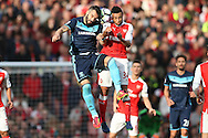 Francis Coquelin of Arsenal and Alvaro Negredo of Middlesbrough both leap to head the ball. Premier league match, Arsenal v Middlesbrough at the Emirates Stadium in London on Saturday 22nd October 2016.<br /> pic by John Patrick Fletcher, Andrew Orchard sports photography.