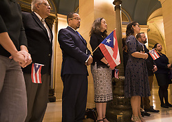October 2, 2017 - St. Paul, MN, U.S.A - Congressman Keith Ellison holds a Puerto Rican flag with University of Minnesota physician Dr. Miguel Fiol on Ellison's left, who was in Puerto Rico during Hurricane Maria, and Aida E. Tosca on Ellison's right, a Puerto Rican living in Minnesota.   ] LEILA NAVIDI • leila.navidi@startribune.com ....BACKGROUND INFORMATION: A group of Minnesota political leaders and representatives of advocacy groups hold a State Capitol news conference on Monday, October 2, 2017 to demand a stronger U.S. response to the unfolding humanitarian crisis in Puerto Rico following Hurricane Maria. (Credit Image: © Leila Navidi/Minneapolis Star Tribune via ZUMA Wire)