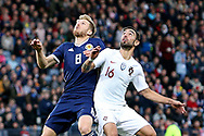 Scotland midfielder Stuart Armstrong (8) (Southampton)  and Portugal midfielder Bruno Fernandes (16) (Sporting Lisbon)  during the Friendly international match between Scotland and Portugal at Hampden Park, Glasgow, United Kingdom on 14 October 2018.